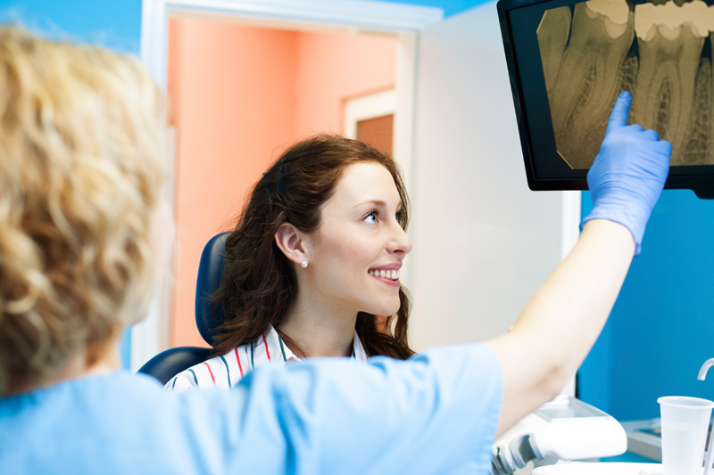 Dentist showing a patient their dental x-rays.