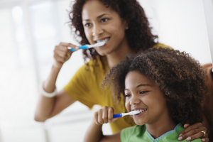Family brushing their together together.